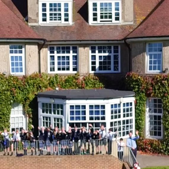 Year 7 watch the drone taking off from the school playing field