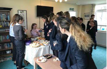 Pupils at cake sale in Sankey's House