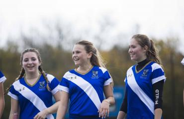 Lancing College pupils play hockey